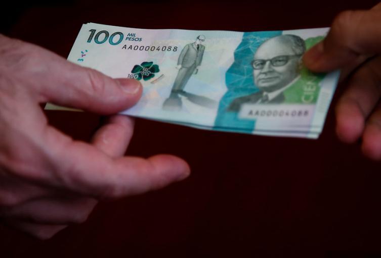 Billetes de 100 mil pesos colombianos