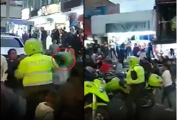 Policía le pega a una mujer con el casco en Usme