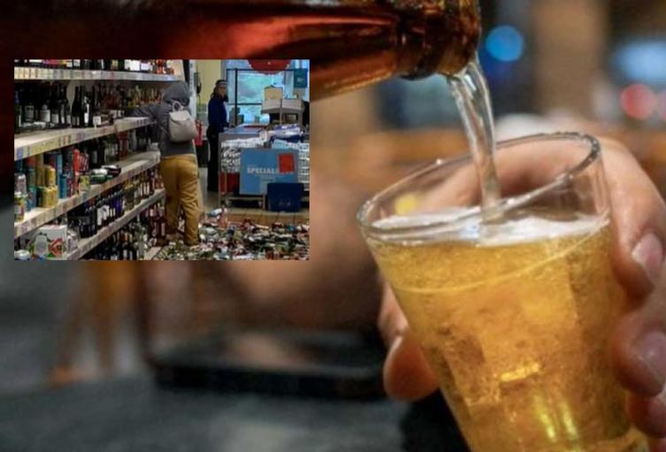 Mujer rompe botellas de licor en supermercado
