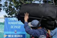 Venezolanos desalojados de campamento humanitario, en Bogotá