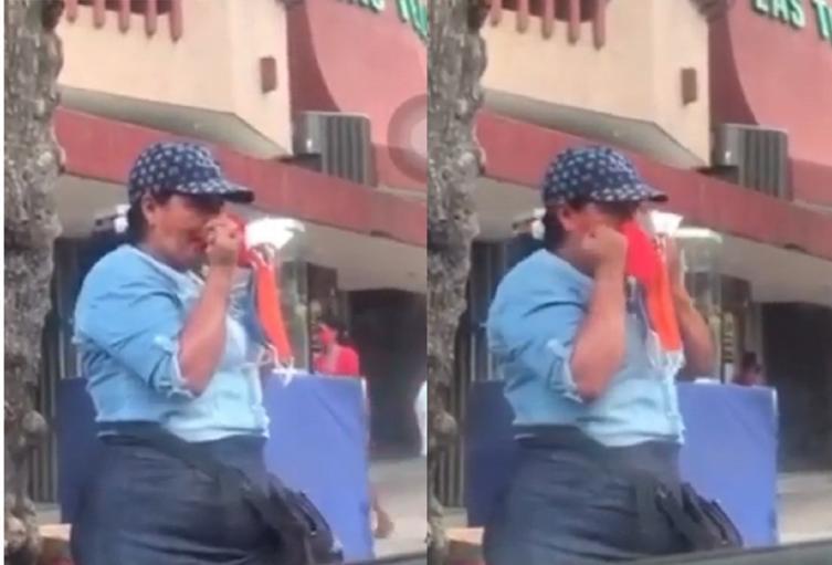 Mujer se limpia con los tapabocas, en Santa Marta