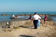 Los guardacostas lograron sacar el cuerpo del mar