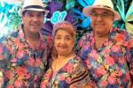 El Checo Acosta junto con sus padres Alci y Ruth.