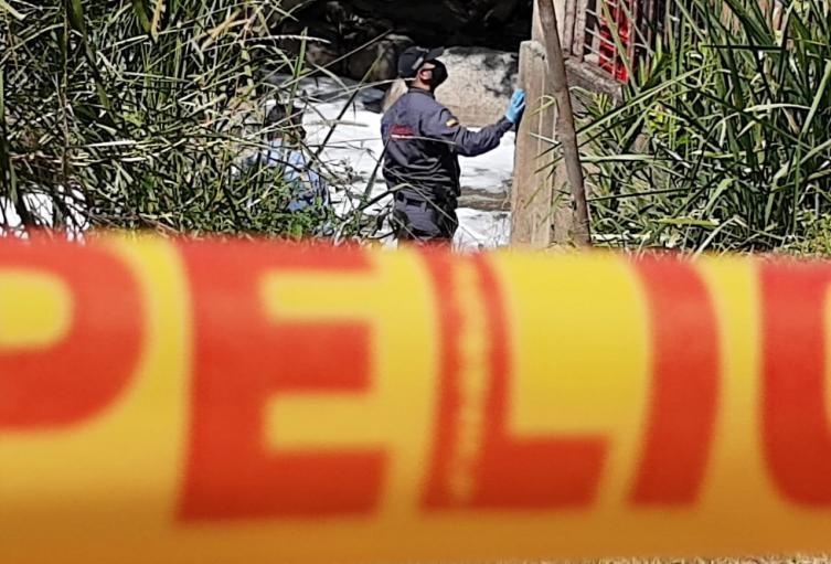 Cadáver en el río Medellín