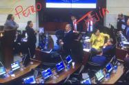 Gustavo Petro, Carlos Felipe Mejía y Álvaro Uribe