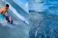 Policía le salva la vida a un niño de un tiburón