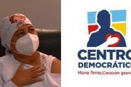 Logotipo del Centro Democrático en la imagen de la primera vacunada, genera polémica en redes