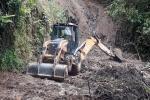 Maquinaria amarilla en la zona rural de Ibagué